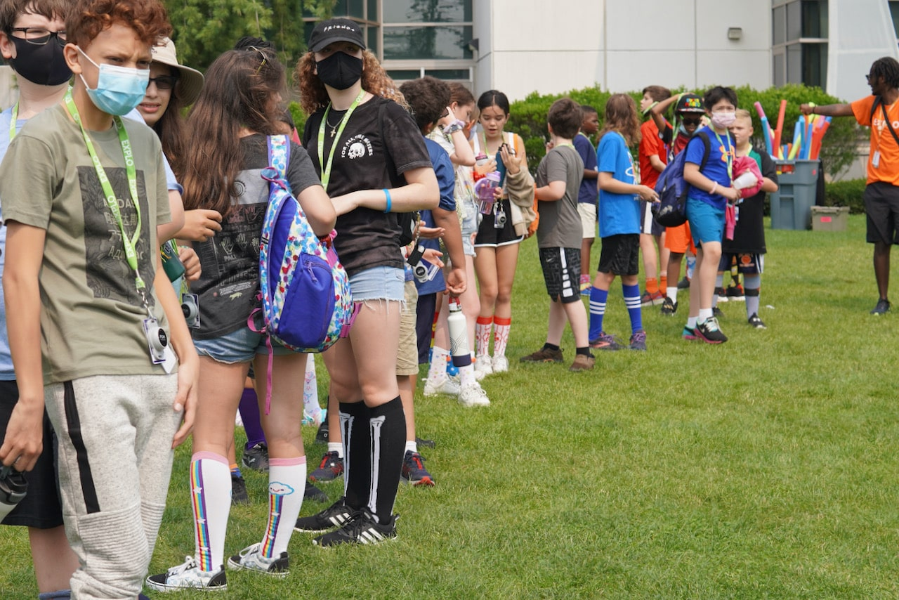 Students line up for their activity on the quad in their tall socks