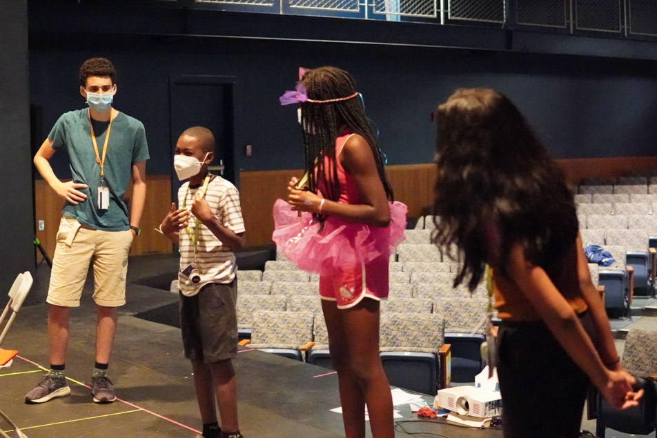 3 students act as the oracle answering and acting out answers from the surrounding group