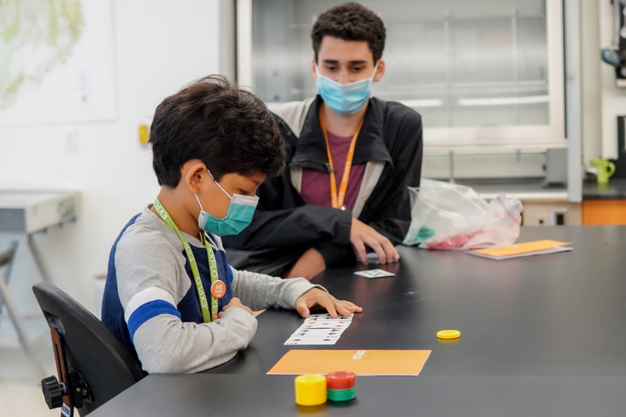 A student looking at their cards to calculate the numbers