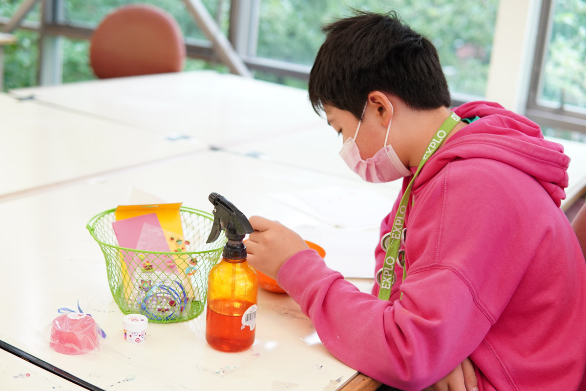 A student mixing their ingredients in the bowl