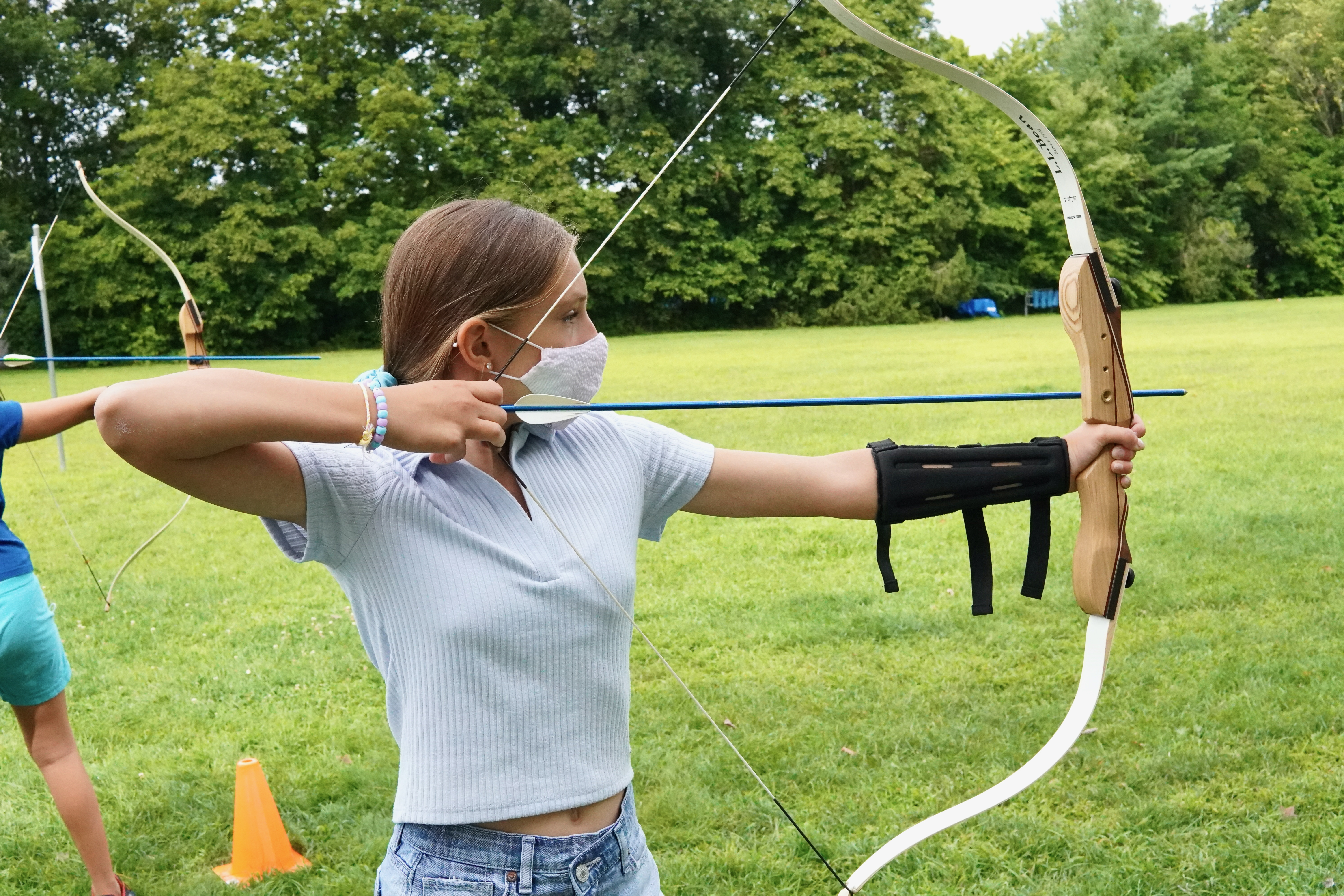 A student practicing form with the bow and arrow