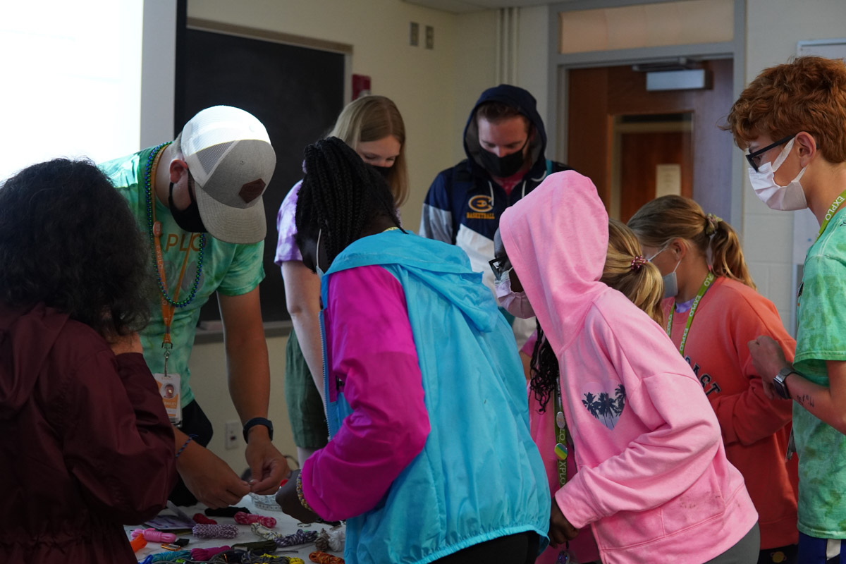 Students picking out accessories for their bracelets and keychains