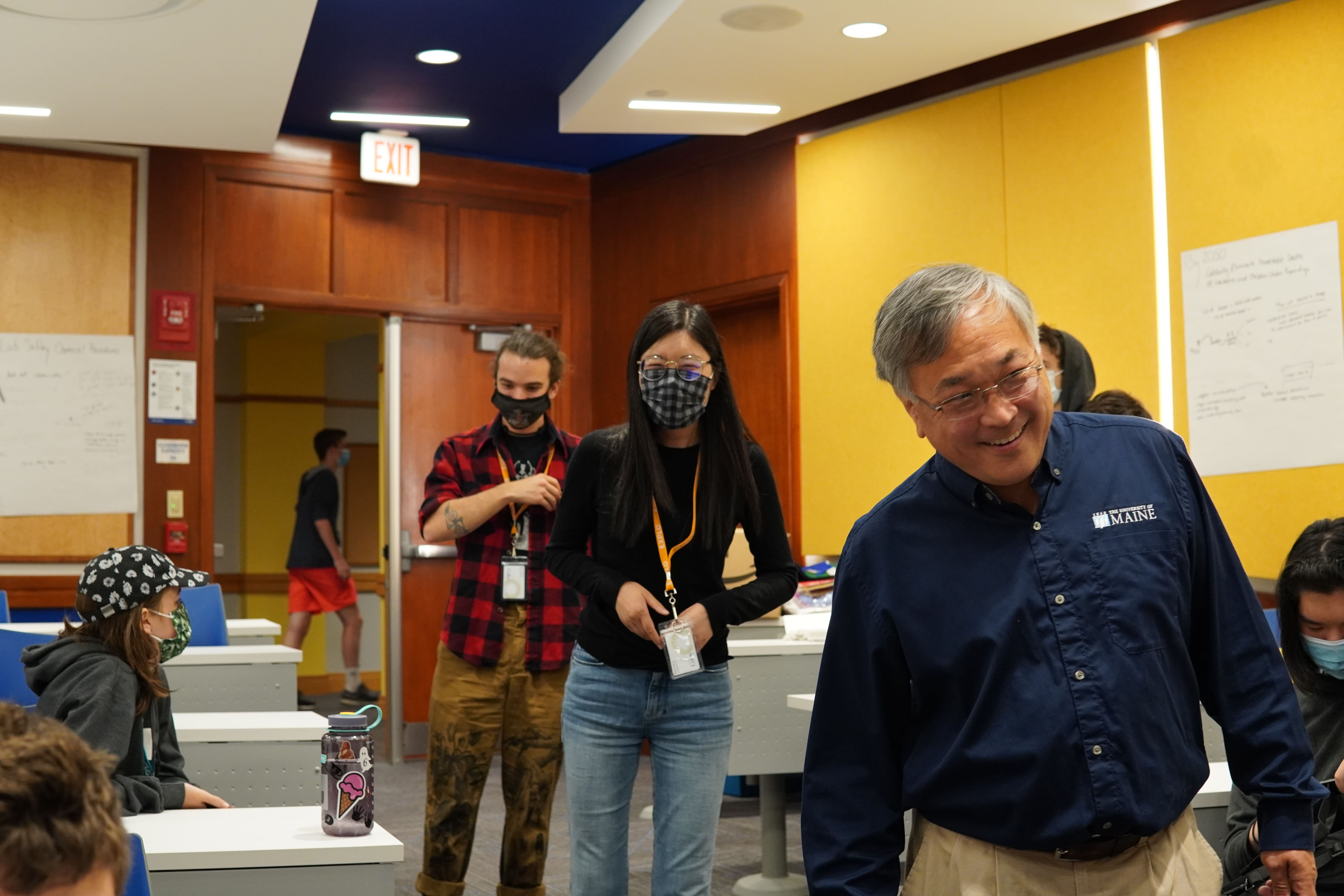 Terry Yoo, Lead Instructor Ann, and Teaching Fellow Sam all share a laugh as they descend the path into the lecture hall.