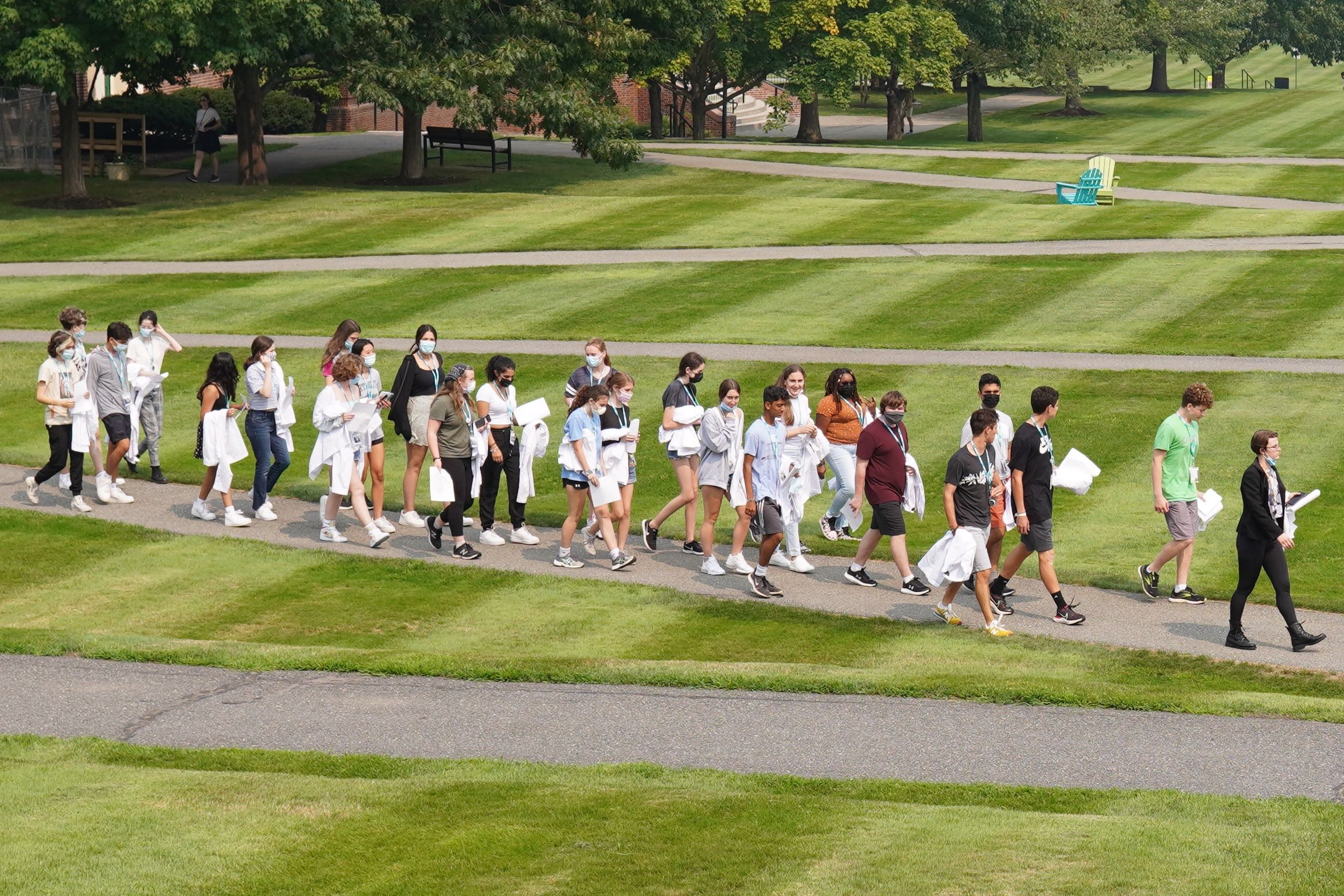 Medical Rotations students follow their Teaching Fellow, Maddie, as they lead them toward the Miller Library.
