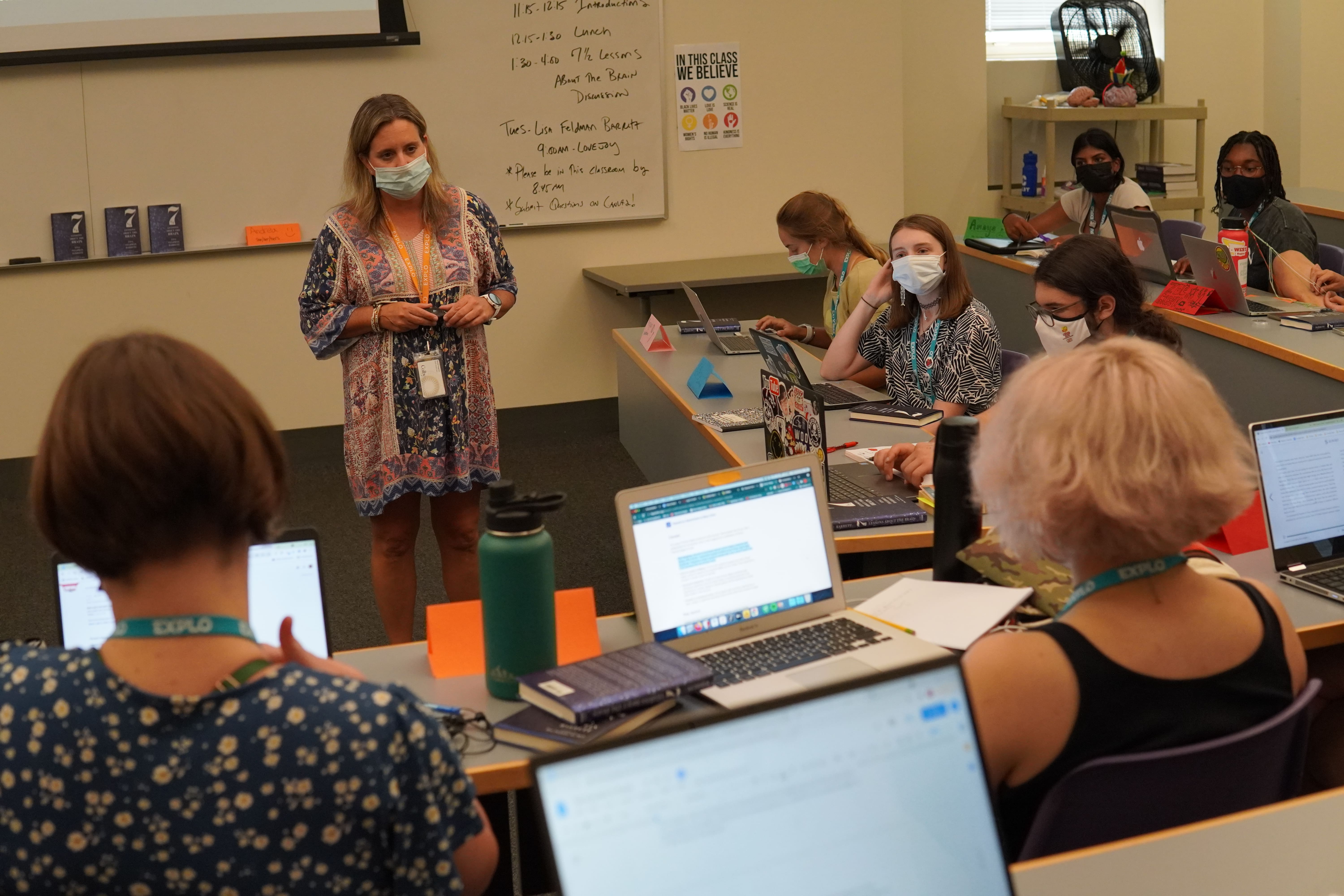 Instructor Lori speaks to students as their class discusses preconceptions about mental health.