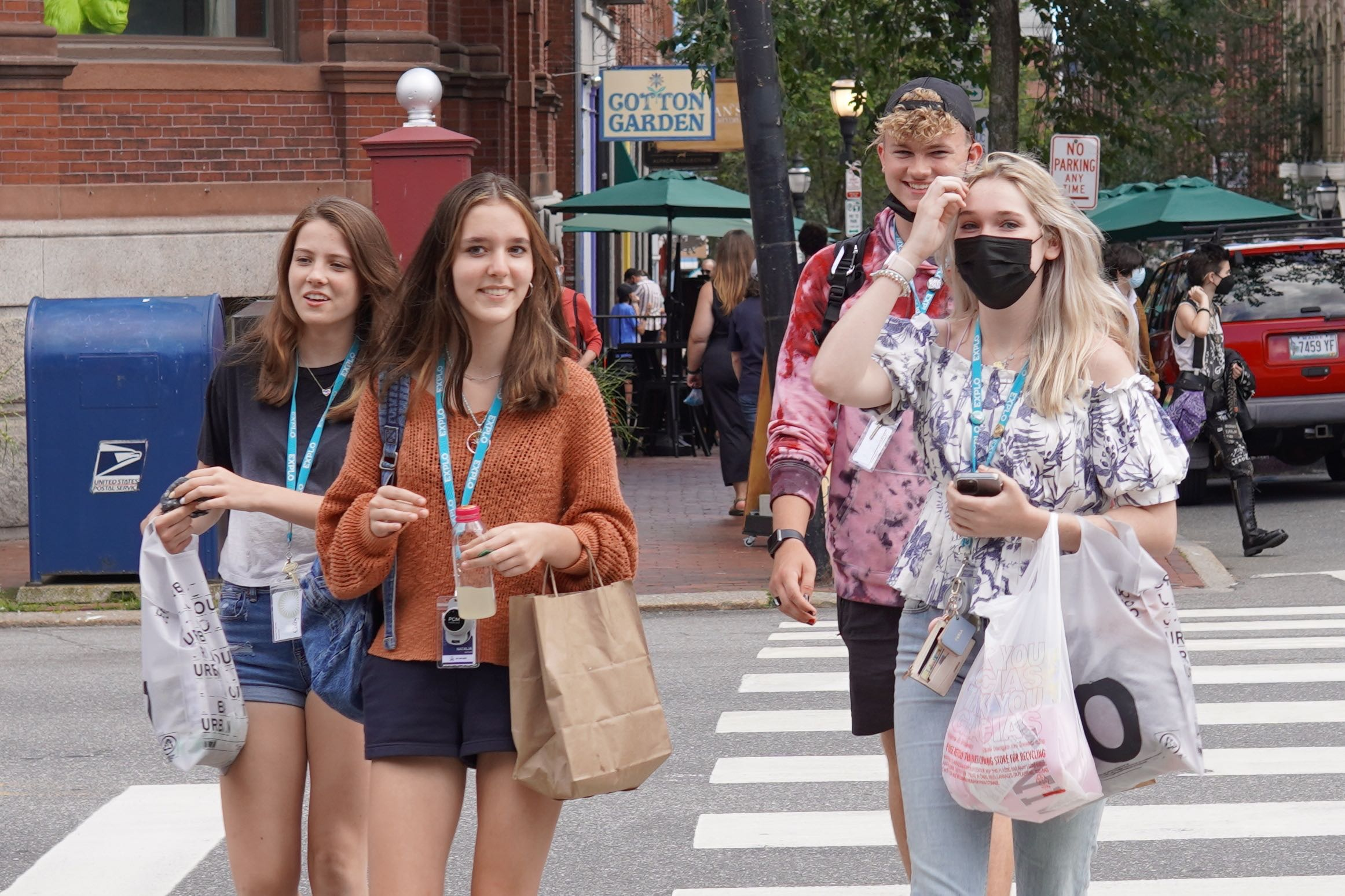 Four smiling students cross the street in Downtown Portland.