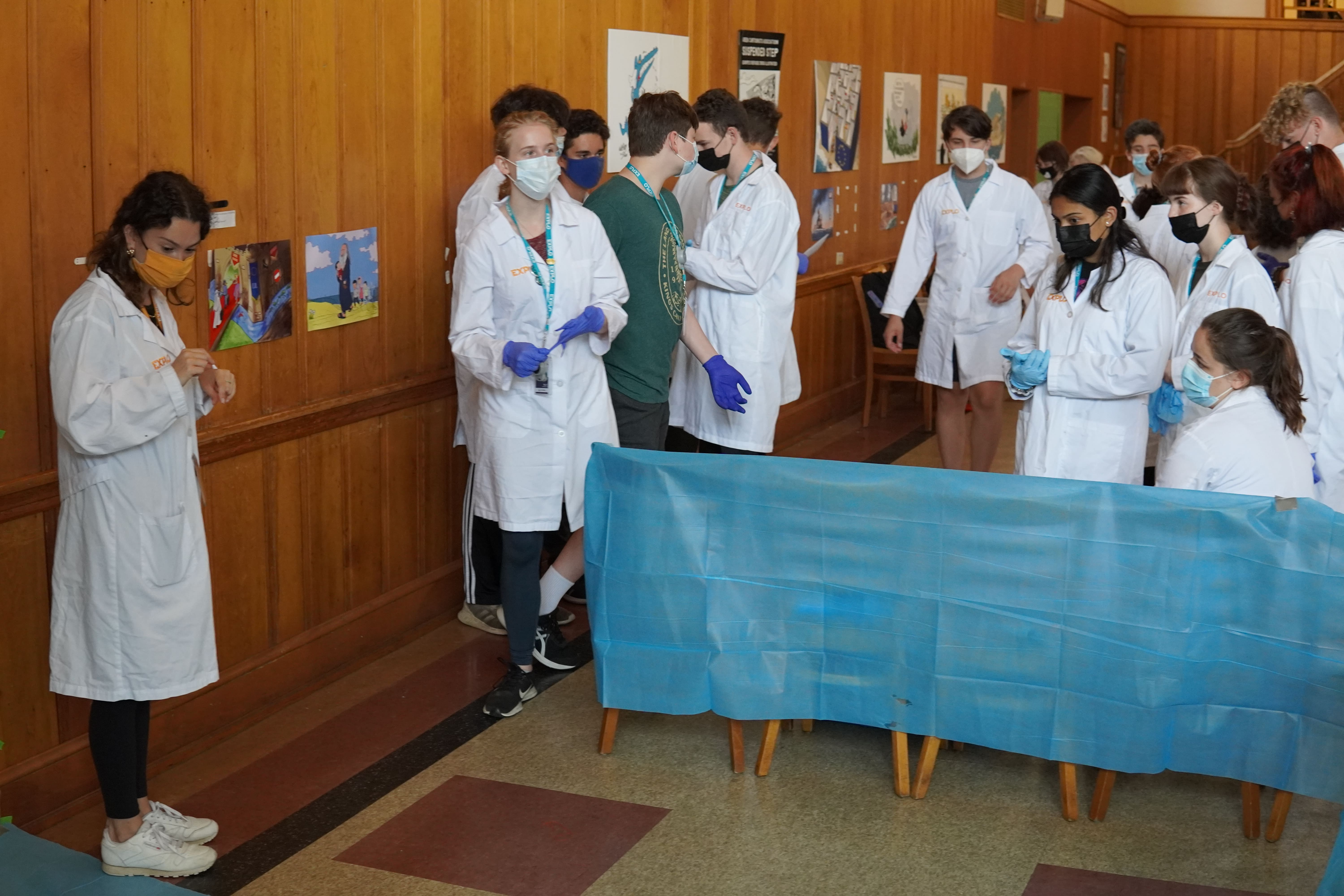 Teaching Fellow Laure prepares a space for students to practice their blood splattering and identification