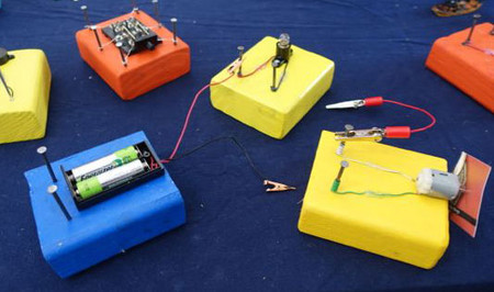 Create Your Own Circuit Blocks Using 2x4 Pieces Of Wood Nails And Electronic Components From Old Toys Like The Folks Brave New Things Pictured